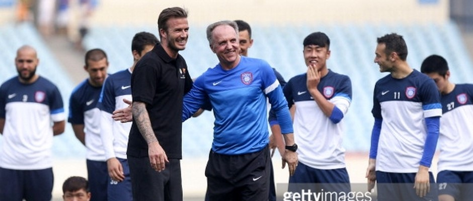 18.6.2013., David Beckham talks with Jiangsu Sainty head coach Dragan Okuka during a training session...